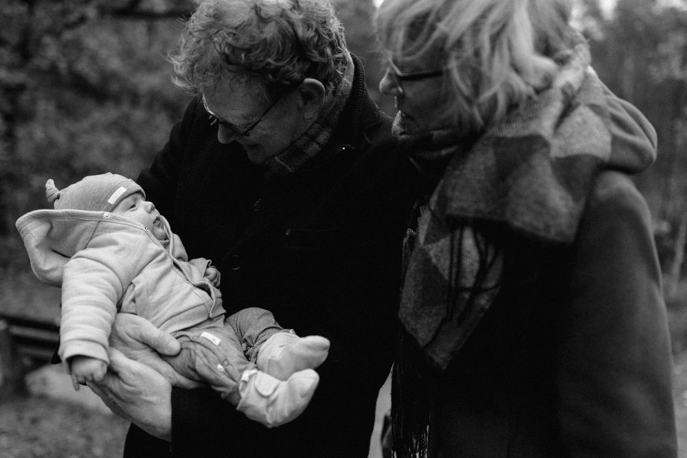 Grandfather and grandmother holding baby