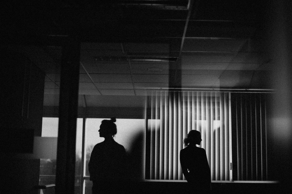 Silhouette of two girls in office building