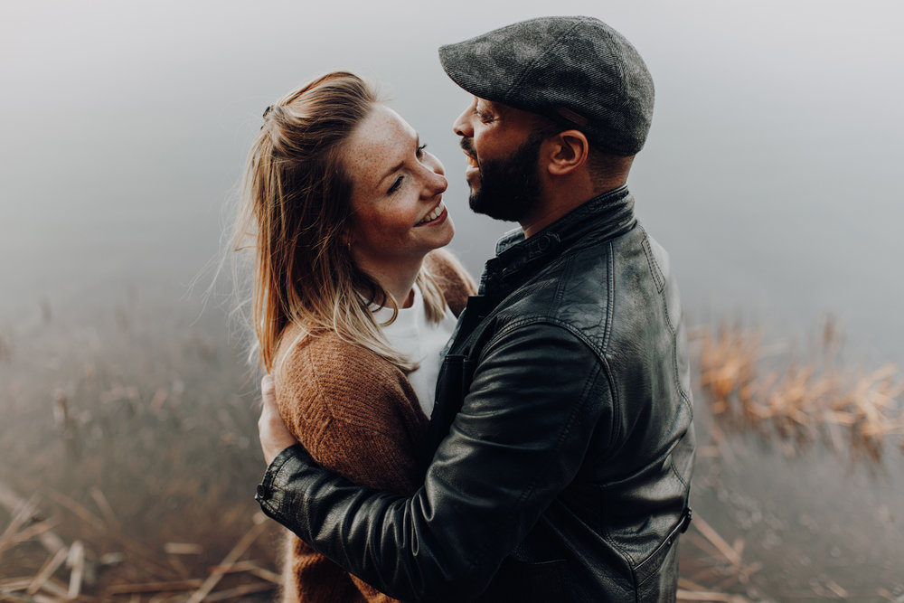 Couple facing each other and smiling