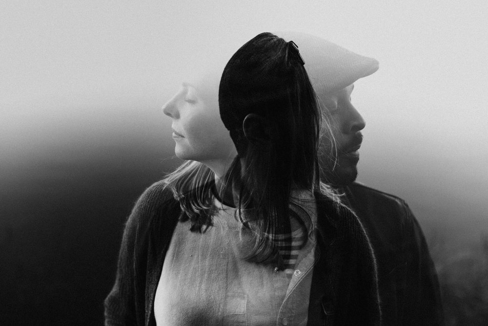 Double exposure of couple facing different directions