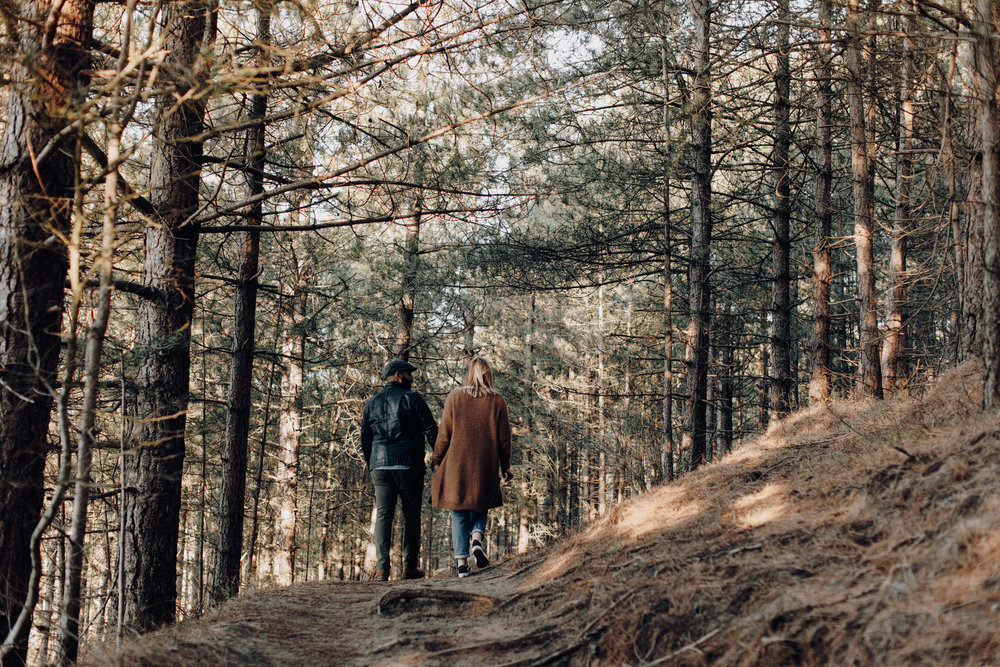 Couple walking away in the forrest