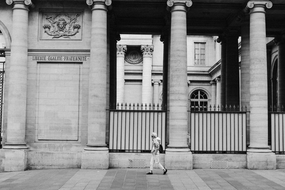 Person walking the streets of Paris, France