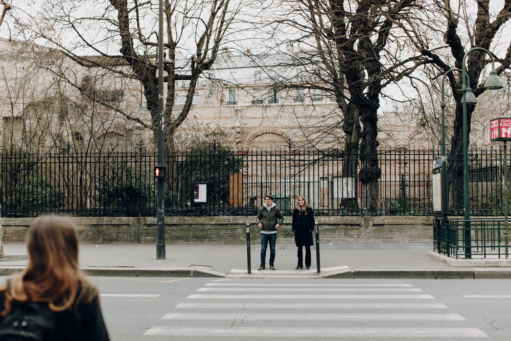 People waiting to cross street in Paris, France