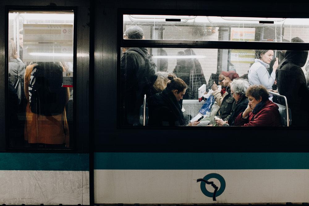 People sitting in metro in Paris, France