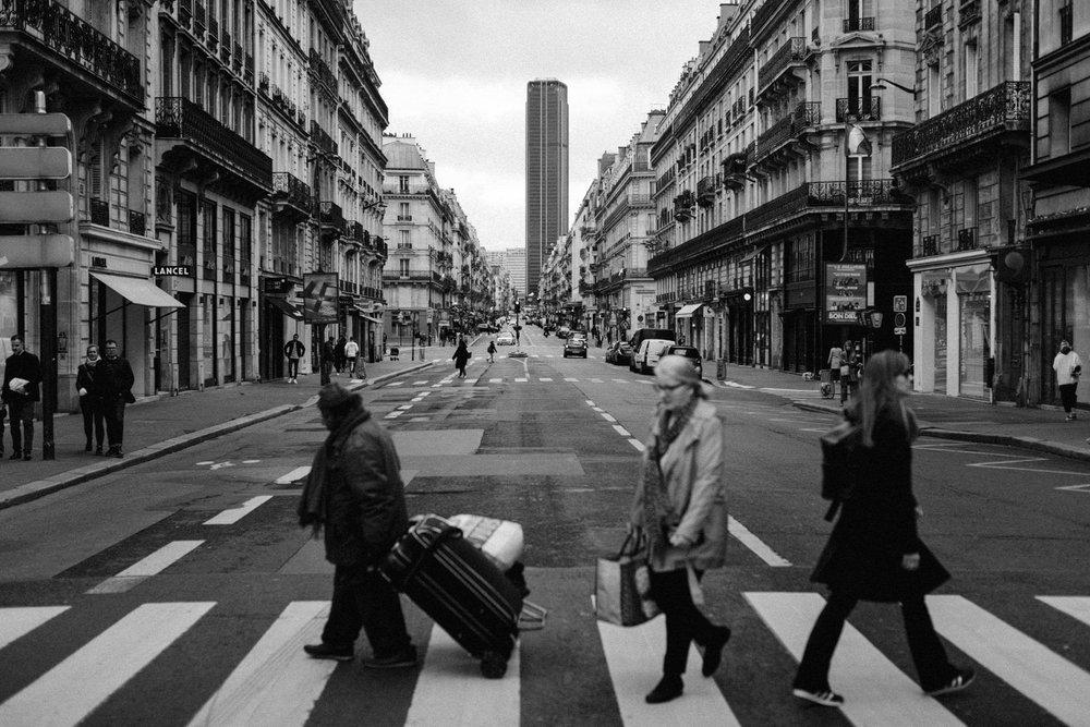 People crossing street on crossover in Paris, France