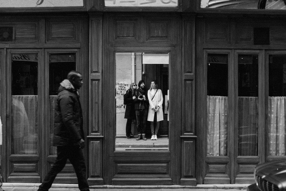 Selfie in mirror on streets of Paris, France