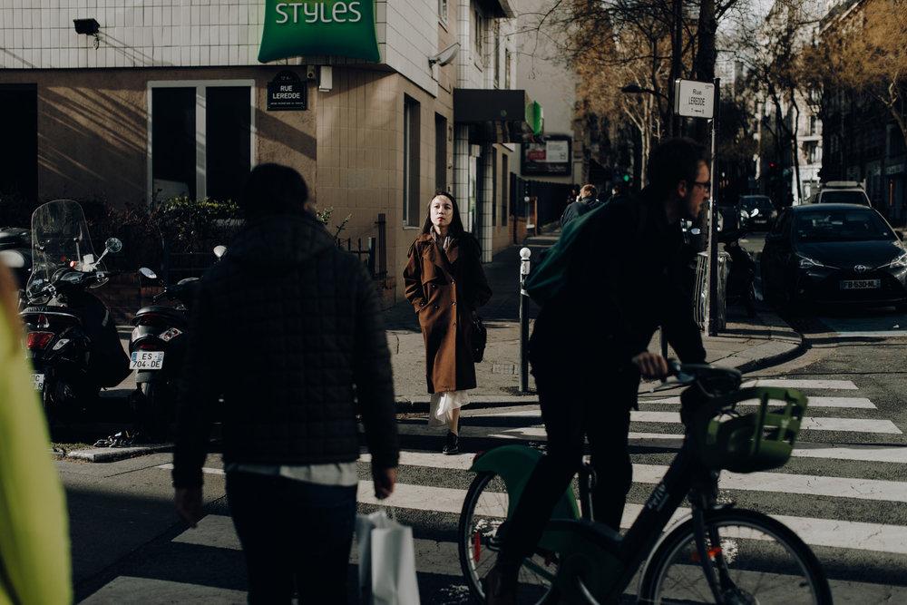 Girl walking in the light in Paris, France