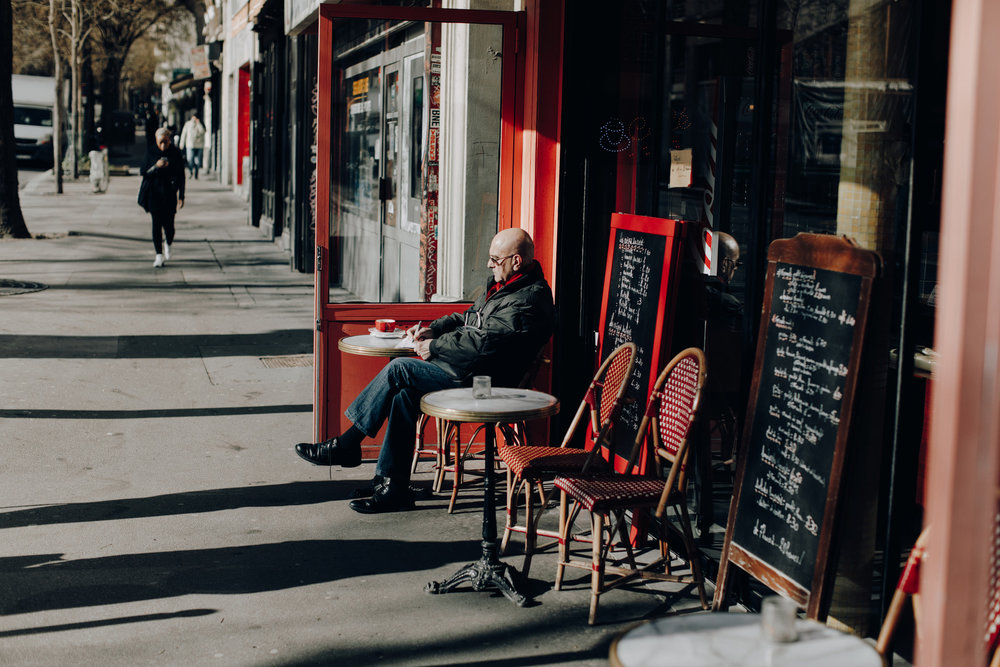 Man sitting on terrace in Paris, France