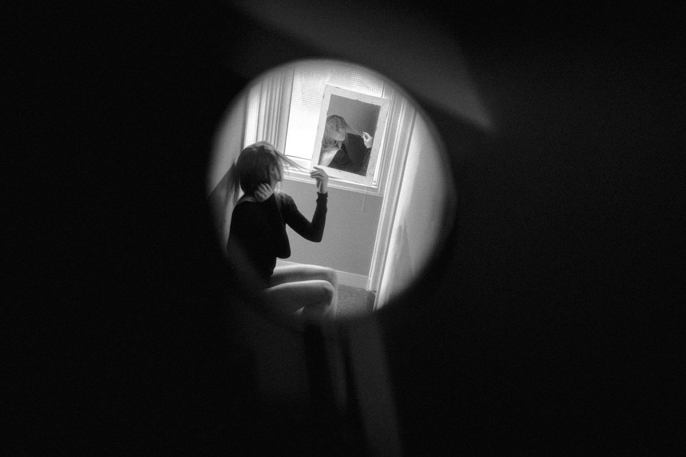 Portrait shot of girl in multiple mirrors