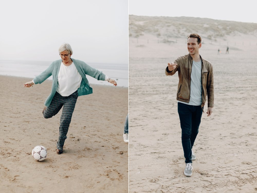 Mother kicking ball at the beach