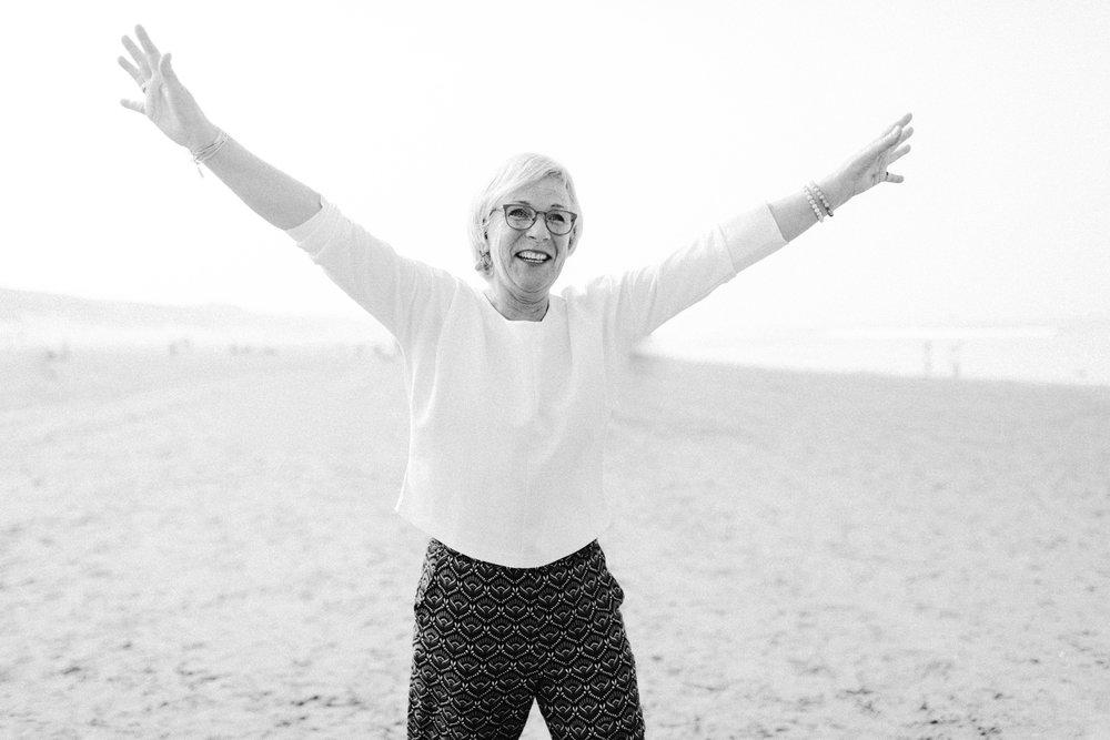 Woman cheering at the beach
