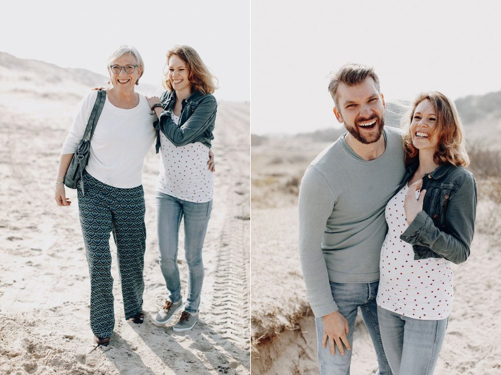People smiling at the camera while at the beach