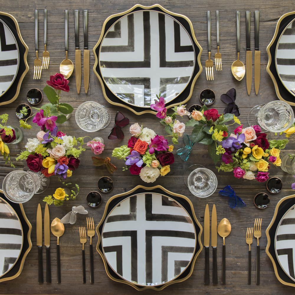 RENT: Anna Weatherley Chargers in Black/Gold + Christian Lacroix Sol Y Sombra Dinnerware + Axel Flatware in Matte 24k Gold/Black + Early American Pressed Glass Goblets + Black Enamel Salt Cellars  SHOP:Christian Lacroix Sol Y Sombra Dinnerware + Black Enamel Salt Cellars