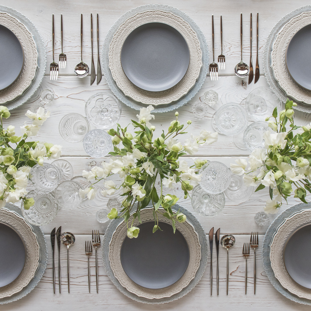 RENT: Lace Chargers in Dusty Blue + Lace Dinnerware in White + Heath Ceramics in Indigo/Slate + Moon Flatware in Polished Steel + Vintage Cut Crystal Goblets + Early American Pressed Glass Goblets + Vintage Champagne Coupes + Antique Crystal Salt Cellars  SHOP:Moon Flatware in Polished Steel