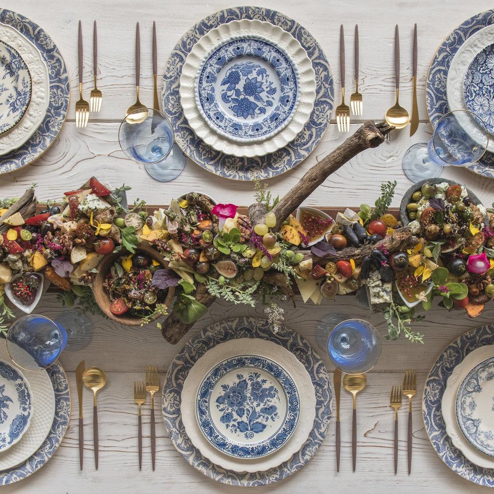 RENT: Blue Fleur de Lis Chargers + White Collection Vintage China + Blue Garden Collection Vintage China + Goa Flatware in Brushed 24k Gold/Wood + Chloe 24k Gold Rimmed Goblet in Light Blue  SHOP:Goa Flatware in 24k Gold/Wood