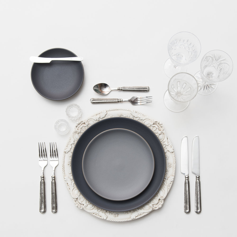 RENT: Verona Chargers in Antique White + Heath Ceramics in Indigo/Slate + Tuscan Flatware in Pewter + Vintage Cut Crystal Goblets + Early American Pressed Glass Goblets + Antique Crystal Salt Cellars   SHOP: Verona Chargers in Antique White