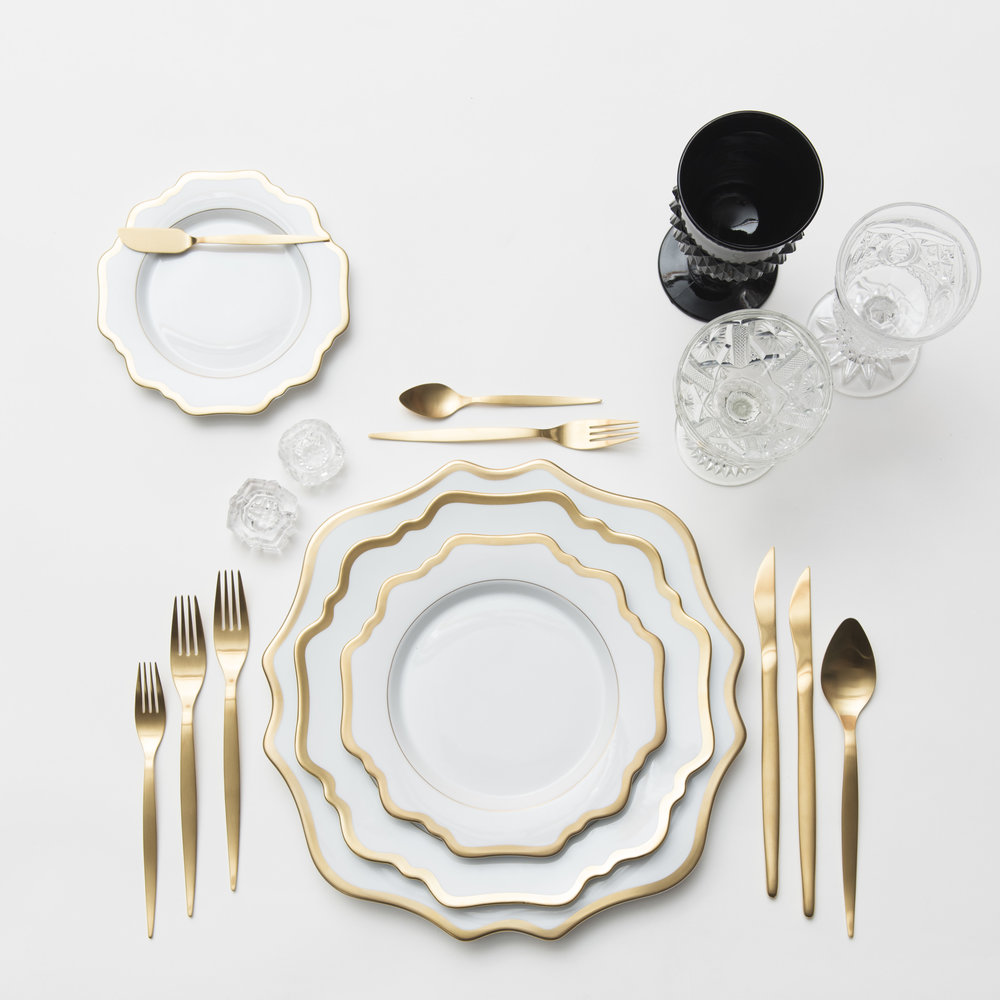 RENT: Anna Weatherley Chargers/Dinnerware in White/Gold + Celeste Flatware in Matte Gold + Black Vintage Goblets + Early American Pressed Glass Goblets + Vintage Champagne Coupes + Antique Crystal Salt Cellars  SHOP: Anna Weatherley Chargers/Dinnerware in White/Gold