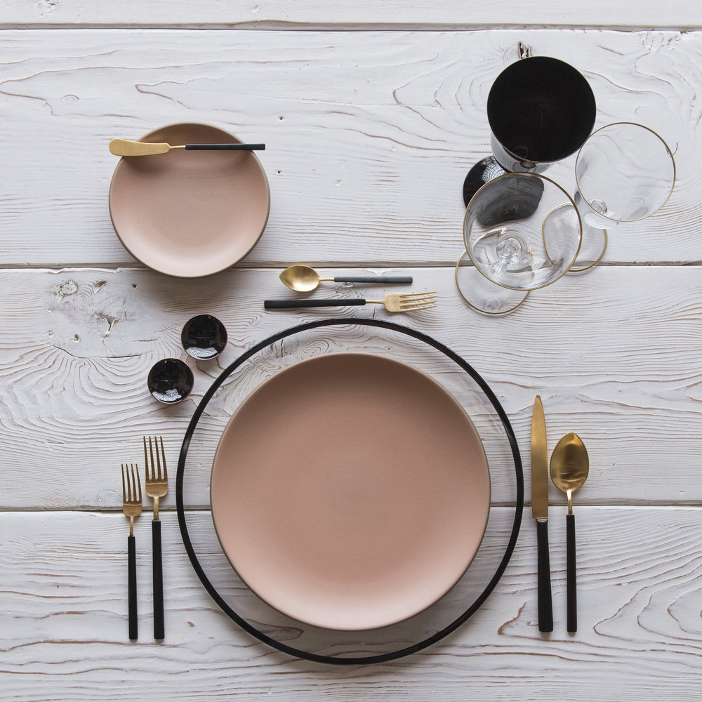 RENT: Halo Glass Chargers in Black + Custom Heath Ceramics in Sunrise + Axel Flatware in Matte 24k Gold/Black + Chloe 24k Gold Rimmed Stemware + Chloe 24k Gold Rimmed Goblet in Black + Black Enamel Salt Cellars  SHOP: Halo Glass Chargers in Black + Chloe 24k Gold Rimmed Stemware + Black Enamel Salt Cellars