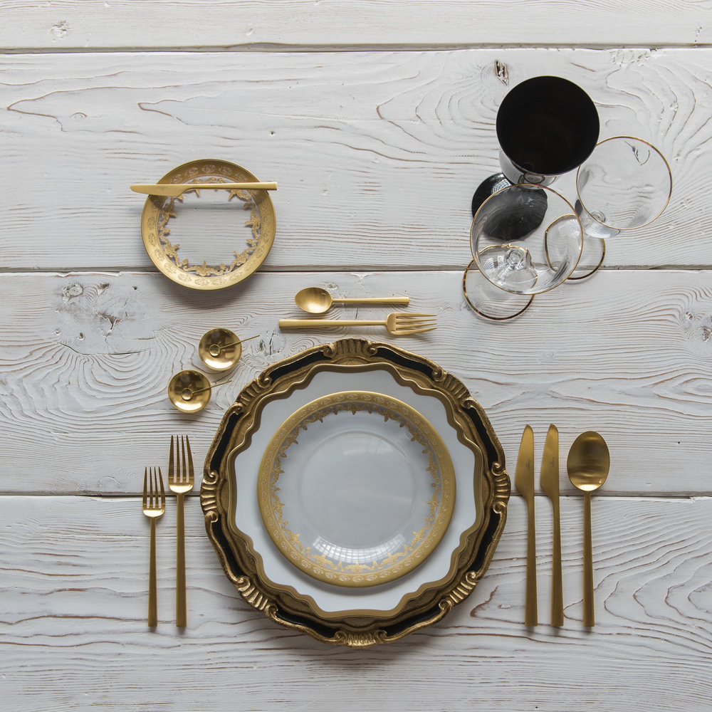 RENT: Florentine Chargers in Black/Gold + Anna Weatherley Dinnerware in White/Gold + Versailles Glass Dinnerware in 24k Gold + Rondo Flatware in Brushed 24k Gold + Chloe 24k Gold Rimmed Stemware + Chloe 24k Gold Rimmed Goblet in Black + 14k Gold Salt Cellars + Tiny Gold Spoons   SHOP: Florentine Chargers in Black/Gold + Anna Weatherley Dinnerware in White/Gold + Rondo Flatware in Brushed 24k Gold + Chloe 24k Gold Rimmed Stemware + 14k Gold Salt Cellars + Tiny Gold Spoons