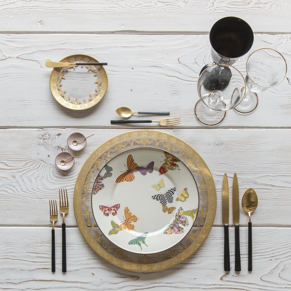 RENT: Versailles Glass Chargers/Dinnerware in 24k Gold + MacKenzie-Childs Butterfly Garden Collection + Axel Flatware in Matte 24k Gold/Black + Chloe 24k Gold Rimmed Stemware + Chloe 24k Gold Rimmed Goblet in Black + Pink Enamel Salt Cellars + Tiny Gold Spoons  SHOP: Chloe 24k Gold Rimmed Stemware + Pink Enamel Salt Cellars + Tiny Gold Spoons