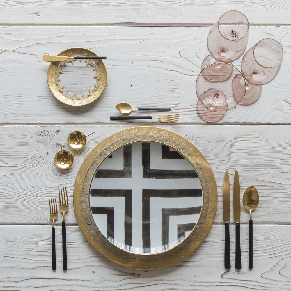 RENT: Versailles Glass Chargers/Dinnerware in 24k Gold + Christian Lacroix Sol Y Sombra Dinnerware + Axel Flatware in Matte 24k Gold/Black + Bella 24k Gold Rimmed Stemware in Blush + 14k Gold Salt Cellars + Tiny Gold Spoons  SHOP:  Bella 24k Gold Rimmed Stemware in Blush + 14k Gold Salt Cellars + Tiny Gold Spoons