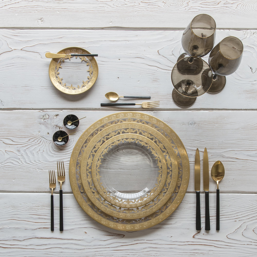 RENT: Versailles Glass Chargers/Dinnerware in 24k Gold + Axel Flatware in Matte 24k Gold/Black + Bella 24k Gold Rimmed Stemware in Smoke + Black Enamel Salt Cellars + Tiny Gold Spoons  SHOP: Bella 24k Gold Rimmed Stemware in Smoke + Black Enamel Salt Cellars + Tiny Gold Spoons