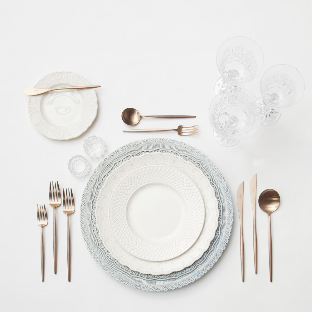 RENT: Lace Chargers in Dusty Blue + White Collection Vintage China + Moon Flatware in Brushed Rose Gold + Czech Crystal Stemware + Antique Crystal Salt Cellars   SHOP: Moon Flatware in Brushed Rose Gold