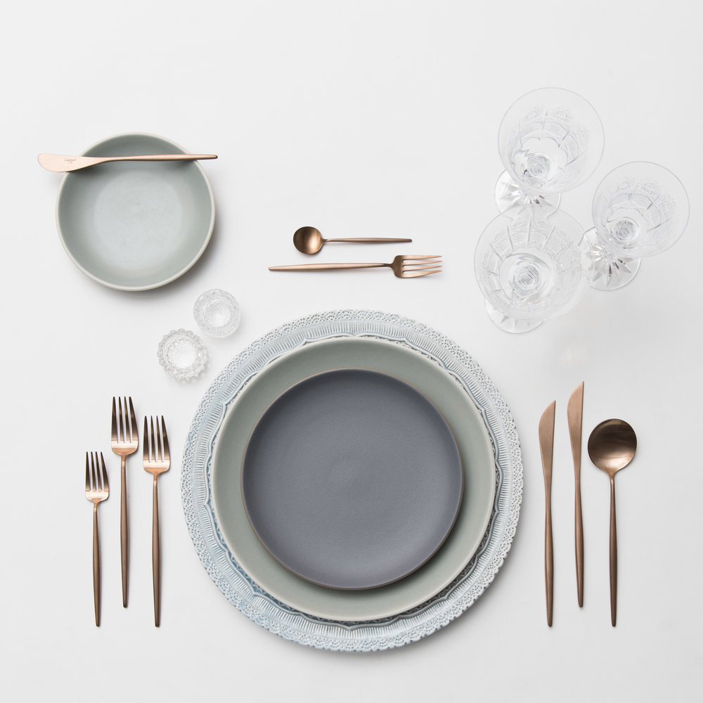 RENT: Lace Chargers in Dusty Blue + Heath Ceramics in Indigo/Slate/Mist + Moon Flatware in Brushed Rose Gold + Czech Crystal Stemware + Antique Crystal Salt Cellars  SHOP: Moon Flatware in Brushed Rose Gold