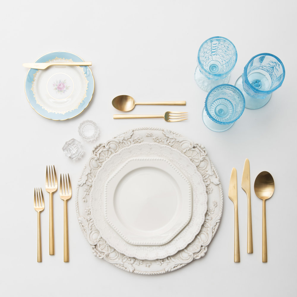 RENT: Verona Chargers in Antique White + White Collection Vintage China + Blue Botanicals Vintage China + Rondo Flatware in Brushed 24k Gold + Aqua Vintage Goblets + Antique Crystal Salt Cellars   SHOP: Rondo Flatware in Brushed 24k Gold