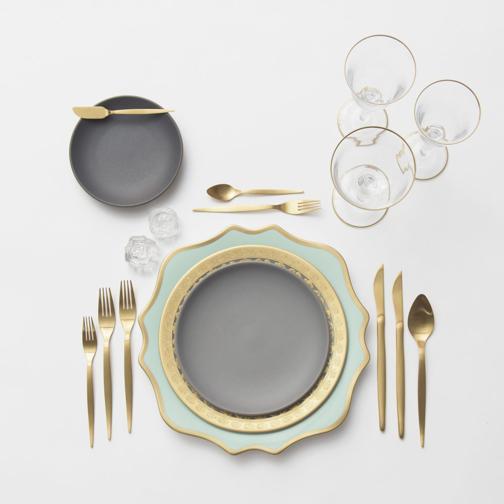 RENT: Anna Weatherley Chargers in Aqua Sky/Gold + Versailles Glass Dinnerware in 24k Gold + Heath Ceramics in Indigo/Slate + Celeste Flatware in Matte Gold + Chloe 24k Gold Rimmed Stemware + Antique Crystal Salt Cellars  SHOP: Anna Weatherley Chargers in Aqua Sky/Gold + Anna Weatherley Dinnerware in White/Gold + Chloe 24k Gold Rimmed Stemware