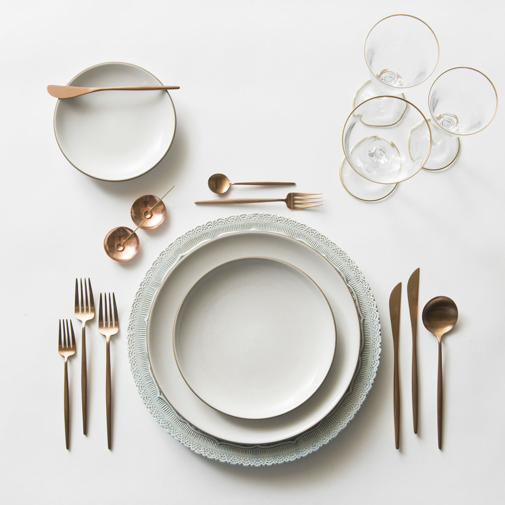 RENT: Lace Chargers in Dusty Blue + Heath Ceramics in Opaque White + Moon Flatware in Brushed Rose Gold + Chloe 24k Gold Rimmed Stemware + Copper Salt Cellars + Tiny Gold/Copper Spoons   SHOP: Moon Flatware in Brushed Rose Gold + Chloe 24k Gold Rimmed Stemware + Copper Salt Cellars