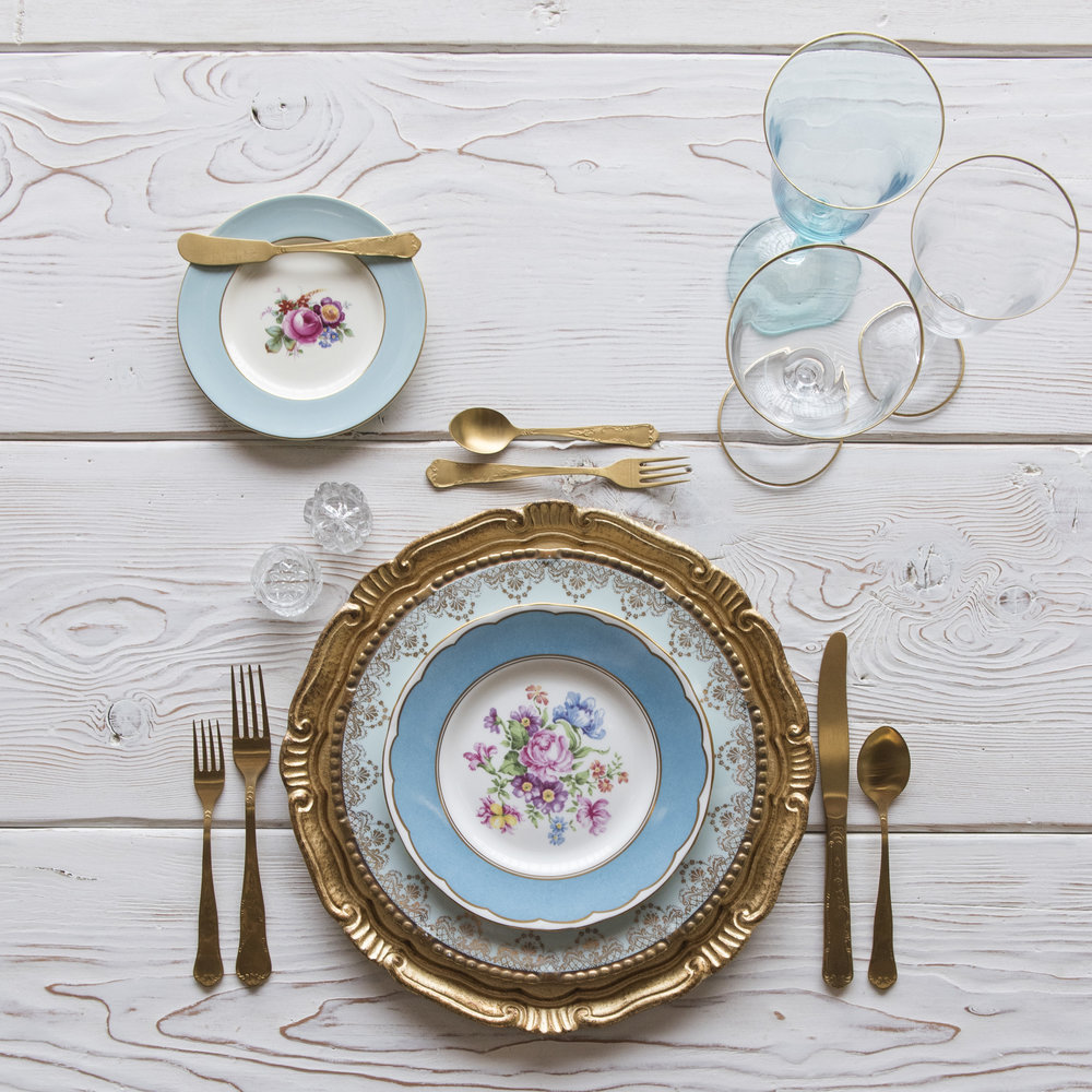 RENT: Florentine Chargers in Gold + Blue Botanicals Vintage China + Chateau Flatware in Matte Gold + Chloe 24k Gold Rimmed Stemware + Chloe 24k Gold Rimmed Goblet in Aqua + Antique Crystal Salt Cellars   SHOP: Florentine Chargers in Gold + Chloe 24k Gold Rimmed Stemware