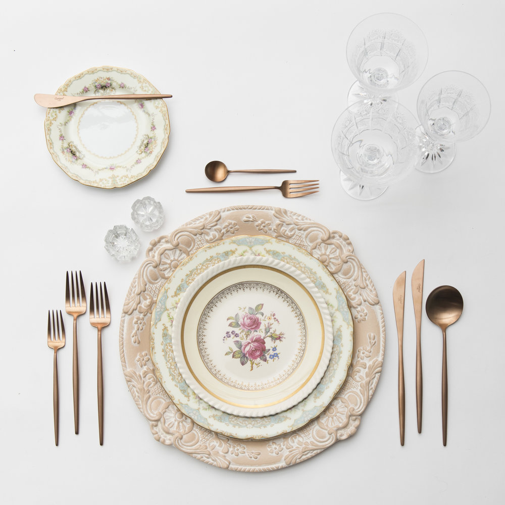 RENT: Verona Chargers in Terracotta + Le Melange Vintage China + Botanicals Collection Vintage China + Moon Flatware in Brushed Rose Gold + Czech Crystal Stemware + Antique Crystal Salt Cellars   SHOP: Verona Chargers in Terracotta + Moon Flatware in Brushed Rose Gold