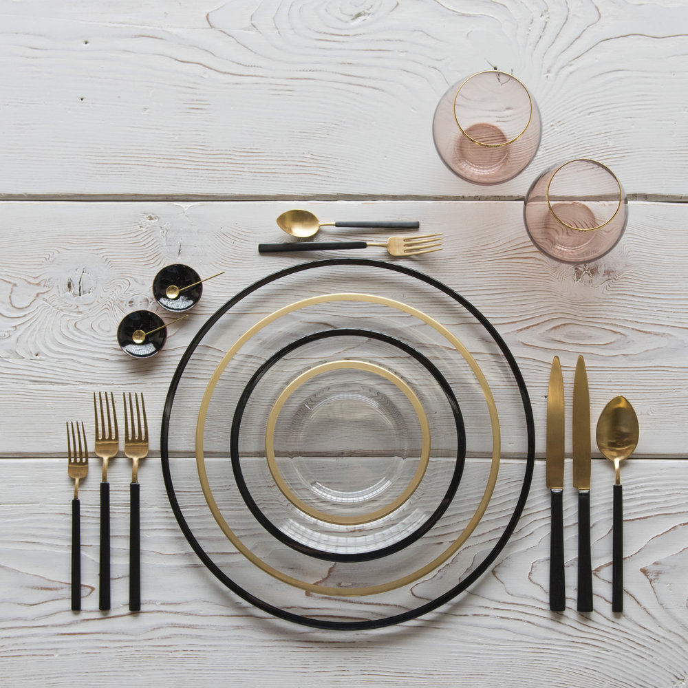 RENT: Halo Glass Chargers in Black + Halo Glass Dinnerware in 24k Gold/Black + Axel Flatware in Matte 24k Gold/Black + Bella 24k Gold Rimmed Stemless Glassware in Blush + Black Enamel Salt Cellars + Tiny Gold Spoons  SHOP: Halo Glass Chargers in Black + Halo Glass Dinnerware in 24k Gold/Black + Bella 24k Gold Rimmed Stemless Glassware in Blush + Black Enamel Salt Cellars + Tiny Gold Spoons