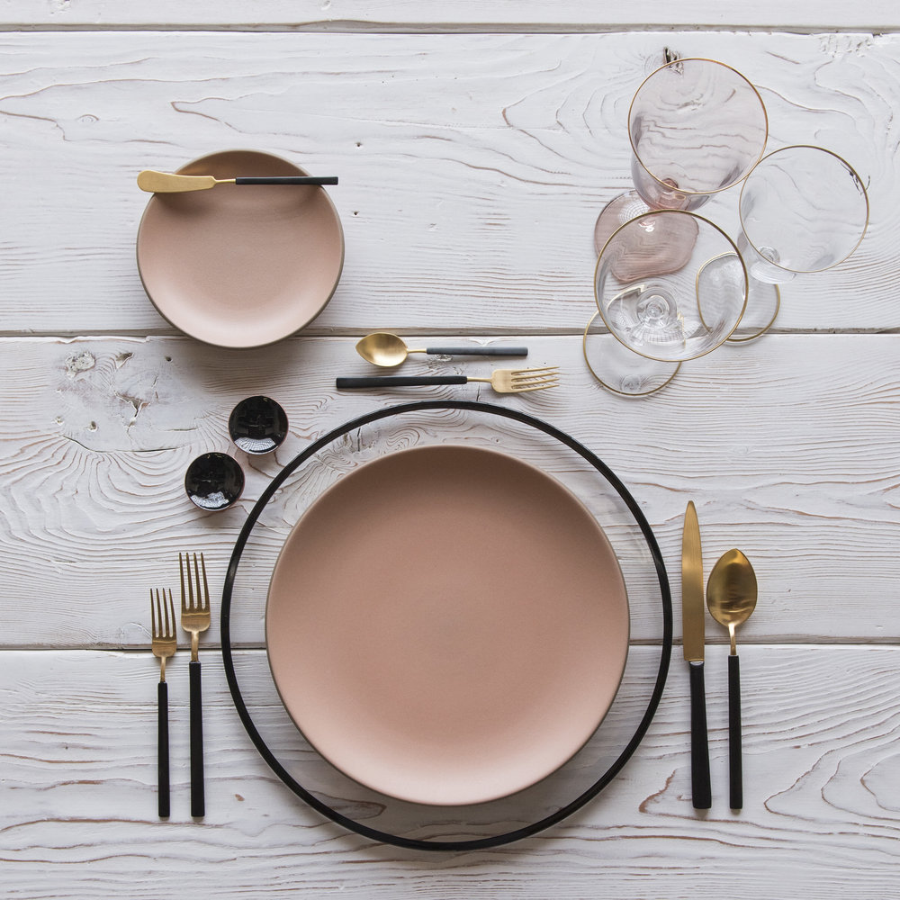 RENT: Halo Glass Chargers in Black + Custom Heath Ceramics in Sunrise + Axel Flatware in Matte 24k Gold/Black + Chloe 24k Gold Rimmed Stemware + Chloe 24k Gold Rimmed Goblet in Blush + Black Enamel Salt Cellars + Tiny Gold Spoons  SHOP: Halo Glass Chargers in Black + Axel Flatware in Matte 24k Gold/Black + Chloe 24k Gold Rimmed Stemware