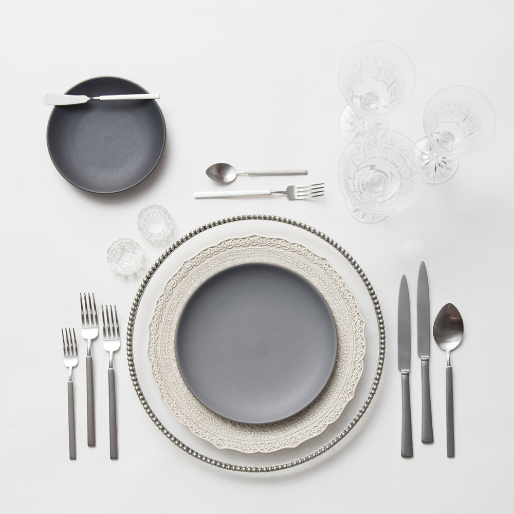 RENT: Pavé Glass Chargers in Pewter + Lace Dinnerware in White + Heath Ceramics in Indigo/Slate + Axel Flatware in Matte Silver + Czech Crystal Stemware + Antique Crystal Salt Cellars