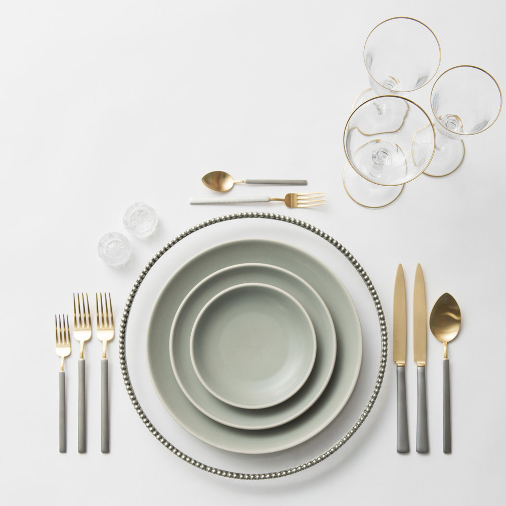 RENT: Pav é Glass Chargers in Pewter  + Heath Ceramics in Mist + Axel Flatware in Matte 24k Gold/Silver + Chloe 24k Gold Rimmed Stemware + Antique Crystal Salt Cellars  SHOP: Chloe 24k Gold Rimmed Stemware