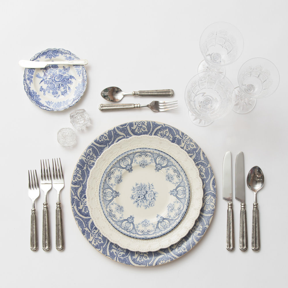 RENT: Blue Fleur de Lis Chargers + White Collection Vintage China + Blue Garden Collection Vintage China + Tuscan Flatware in Pewter + Czech Crystal Stemware + Antique Crystal Salt Cellars