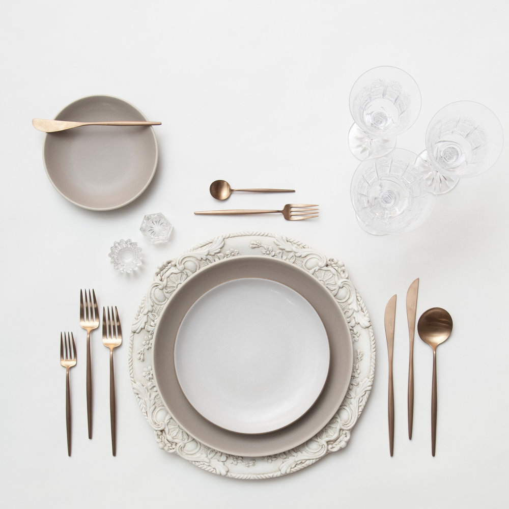 RENT: Verona Chargers in Antique White + Heath Ceramics in French Grey/Opaque White + Moon Flatware in Brushed Rose Gold + Czech Crystal Stemware + Antique Crystal Salt Cellars   SHOP: Verona Chargers in Antique White + Moon Flatware in Brushed Rose Gold