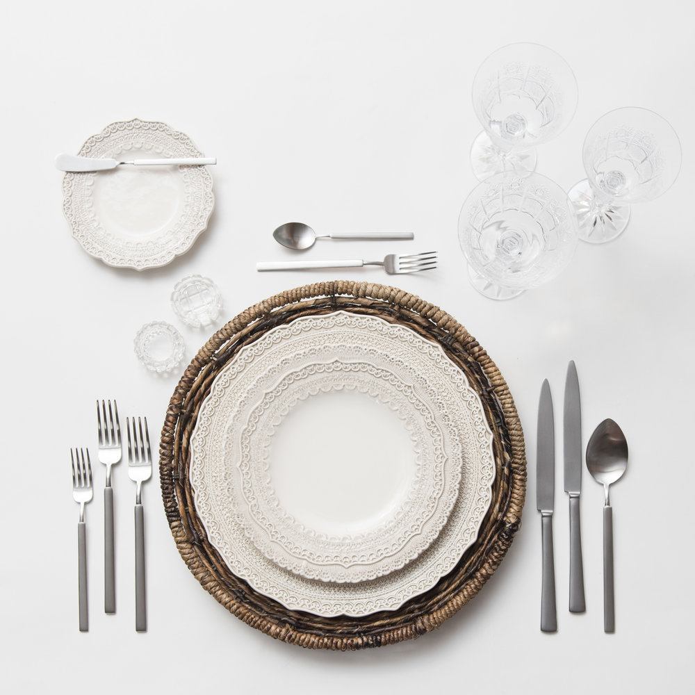 RENT: Natural Woven Chargers + Lace Dinnerware in White + Axel Flatware in Matte Silver + Czech Crystal Stemware + Antique Crystal Salt Cellars