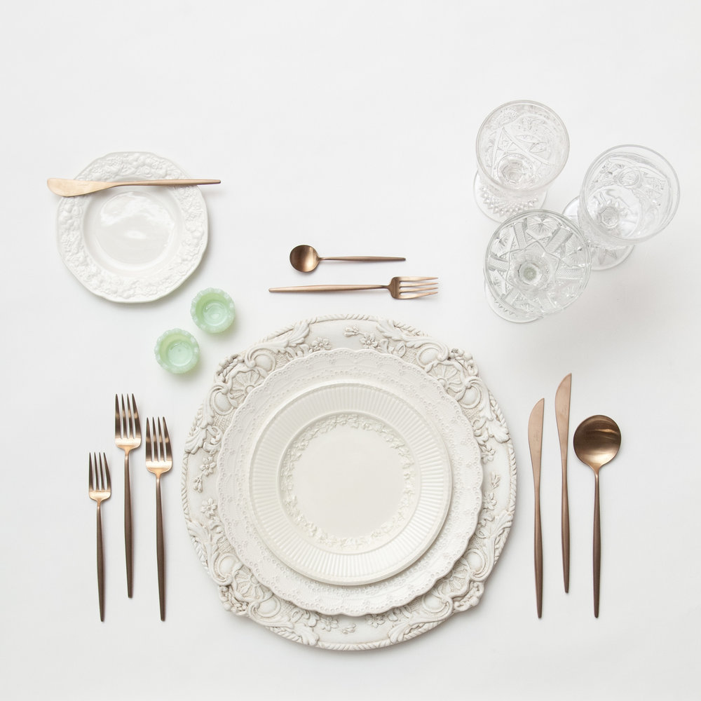RENT: Verona Chargers in Antique White + White Collection Vintage China + Moon Flatware in Brushed Rose Gold + Early American Pressed Glass Goblets + Vintage Champagne Coupes + Jadeite Crystal Salt Cellars  SHOP: Verona Chargers in Antique White + Moon Flatware in Brushed Rose Gold