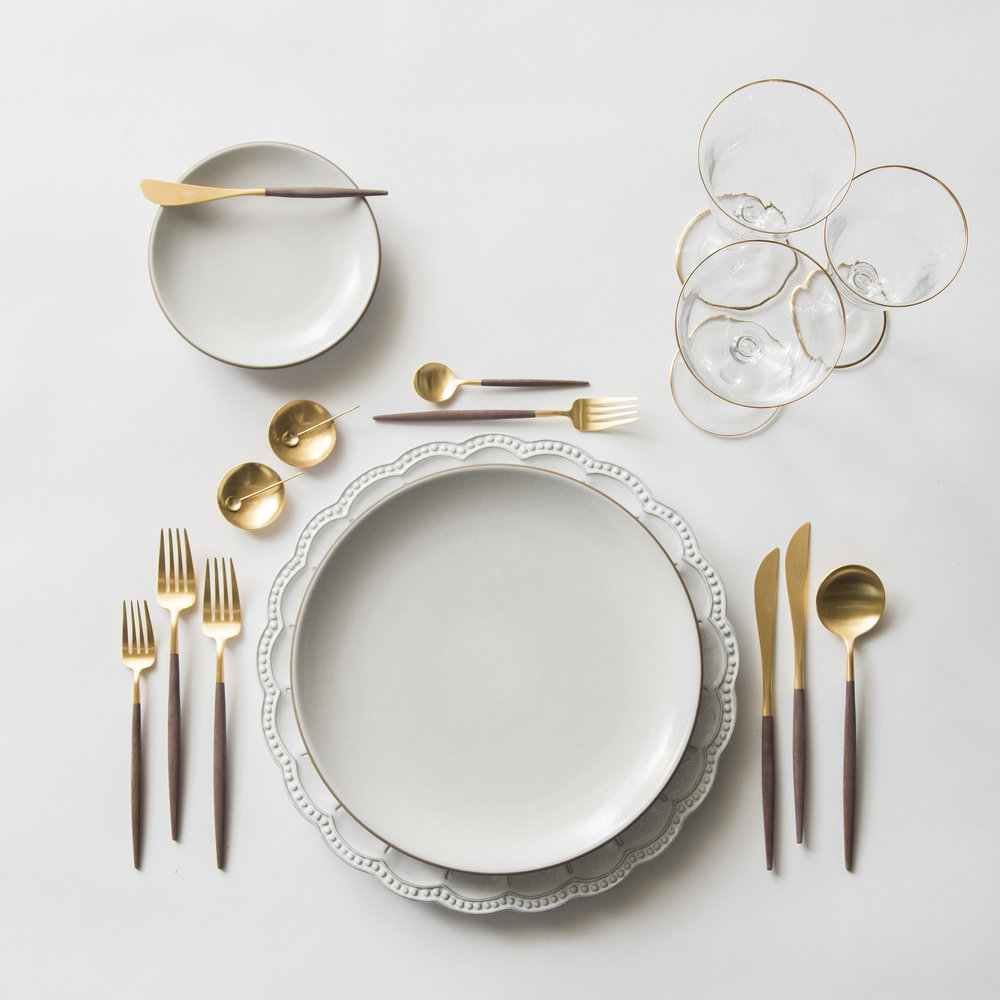 RENT: Signature Collection  Chargers + Heath Ceramics in Opaque White + Goa Flatware in Brushed 24k Gold/Wood + Chloe 24k Gold Rimmed Stemware + 14k Gold Salt Cellars + Tiny Gold Spoons   SHOP:  Goa Flatware in Brushed 24k   Gold/Wood + Chloe 24k Gold Rimmed Stemware + 14k Gold Salt Cellars + Tiny Gold   Spoons