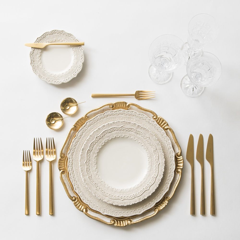 RENT: Florentine Chargers in White/Gold + Lace Dinnerware in White + Rondo Flatware in Brushed 24k Gold + Czech Crystal Stemware + 14k Gold Salt Cellars + Tiny Gold Spoons  SHOP: Florentine Chargers in White/Gold + Rondo Flatware in Brushed 24k Gold + 14k Gold Salt Cellars + Tiny Gold Spoons