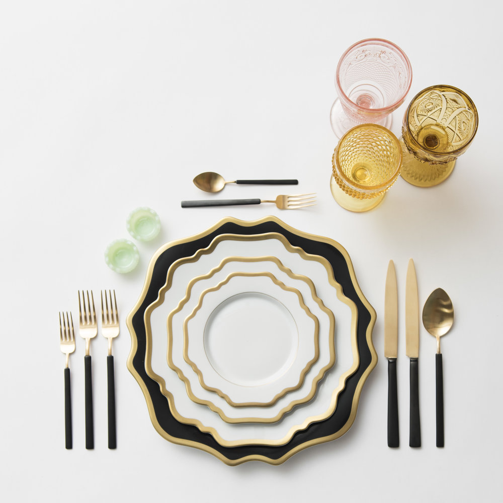 RENT: Anna Weatherley Chargers in Black/Gold + Anna Weatherley Dinnerware in White/Gold + Axel Flatware in Matte 24k Gold/Black + Pink/Amber/Yellow Vintage Goblets + Jadeite Crystal Salt Cellars  SHOP: Anna Weatherley Dinnerware in White/Gold