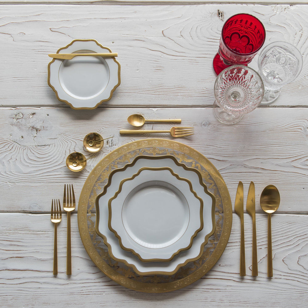 RENT: Versailles Glass Chargers in 24k Gold + Anna Weatherley Dinnerware in White/Gold + Rondo Flatware in Brushed 24k Gold + Red Vintage Goblets + Early American Pressed Glass Goblets + Vintage Champagne Coupes + 14k Gold Salt Cellars + Tiny Gold Spoons   SHOP: Anna Weatherley Dinnerware in White/Gold + Rondo Flatware in Brushed 24k Gold + 14k Gold Salt Cellars + Tiny Gold Spoons
