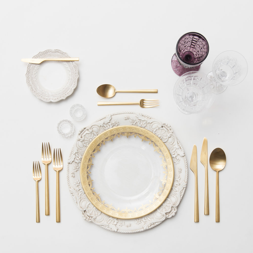 RENT: Verona Chargers in Antique White + Versailles Glass Dinnerware in 24k Gold + Rondo Flatware in Brushed 24k Gold + Purple Vintage Goblets + Czech Crystal Stemware + Antique Crystal Salt Cellars   SHOP: Verona Chargers in Antique White + Rondo Flatware in Brushed 24k Gold