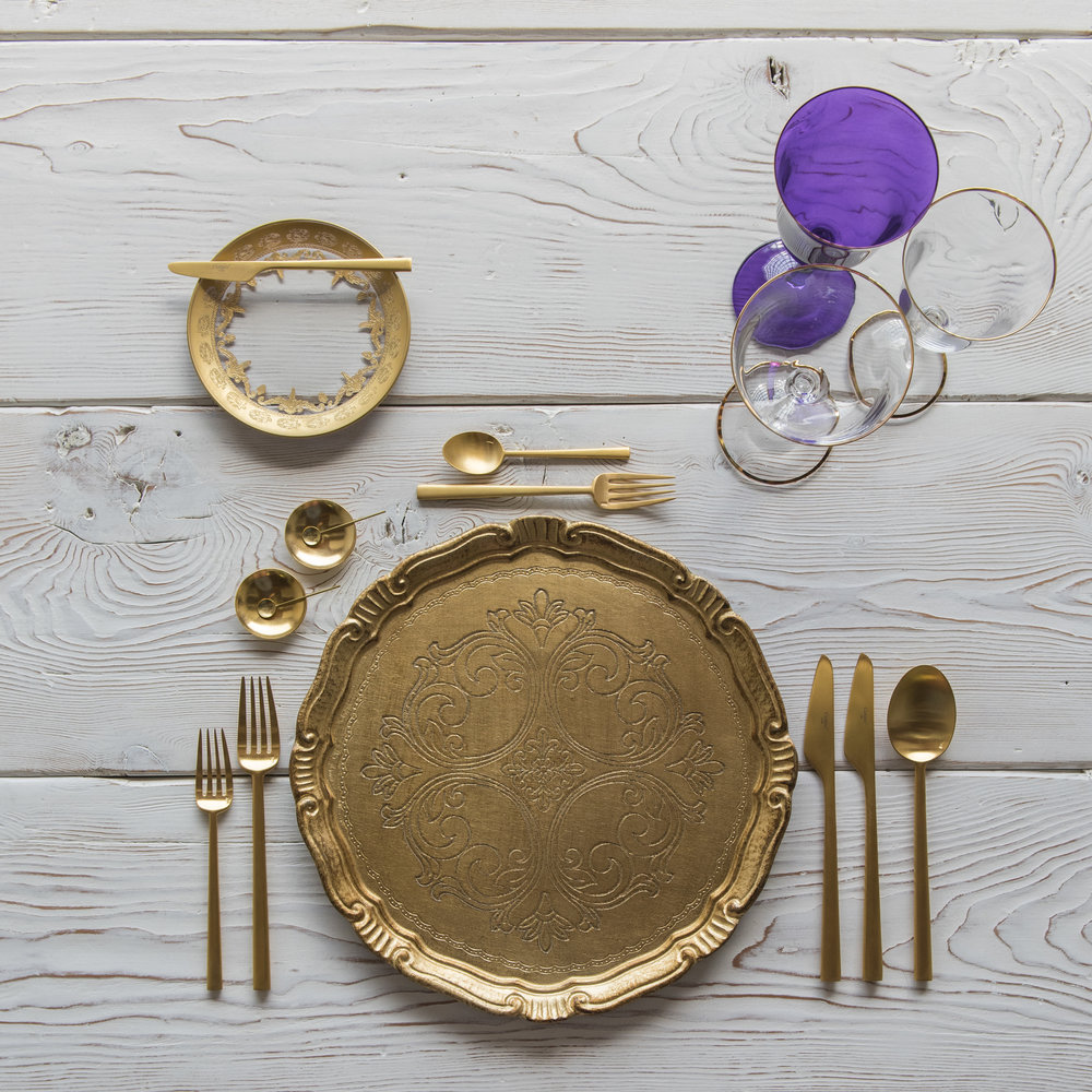RENT: Florentine Chargers in Gold + Versailles Glass Dinnerware in 24k Gold + Rondo Flatware in Brushed 24k Gold + Chloe 24k Gold Rimmed Stemware + Chloe 24k Gold Rimmed Goblet in Purple + 14k Gold Salt Cellars + Tiny Gold Spoons  SHOP: Florentine Chargers in Gold + Rondo Flatware in Brushed 24k Gold + Chloe 24k Gold Rimmed Stemware + 14k Gold Salt Cellars + Tiny Gold Spoons