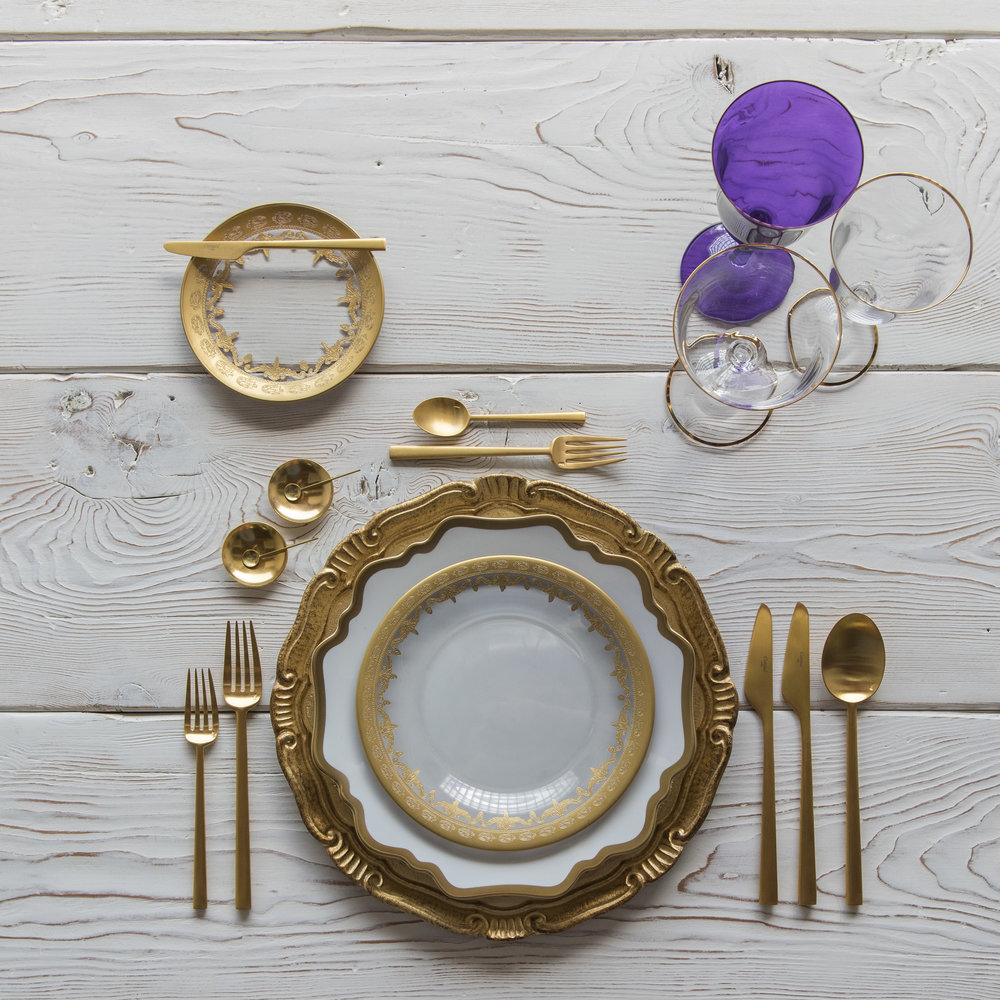 RENT: Florentine Chargers in Gold + Anna Weatherley Dinnerware in White/Gold + Versailles Glass Dinnerware in 24k Gold + Rondo Flatware in Brushed 24k Gold + Chloe 24k Gold Rimmed Stemware + Chloe 24k Gold Rimmed Goblet in Purple + 14k Gold Salt Cellars + Tiny Gold Spoons  SHOP: Florentine Chargers in Gold + Anna Weatherley Dinnerware in White/Gold + Rondo Flatware in Brushed 24k Gold + Chloe 24k Gold Rimmed Stemware + 14k Gold Salt Cellars + Tiny Gold Spoons