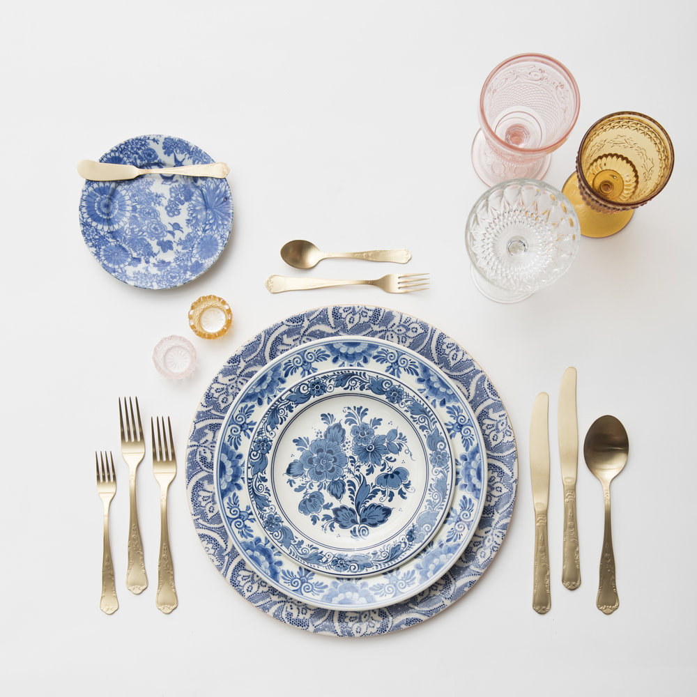 RENT: Blue Fleur de Lis Chargers + Blue Garden Collection Vintage China + Chateau Flatware in Matte Gold + Pink/Amber Vintage Goblets + Vintage Champagne Coupes + Pink/Amber Crystal Salt Cellars