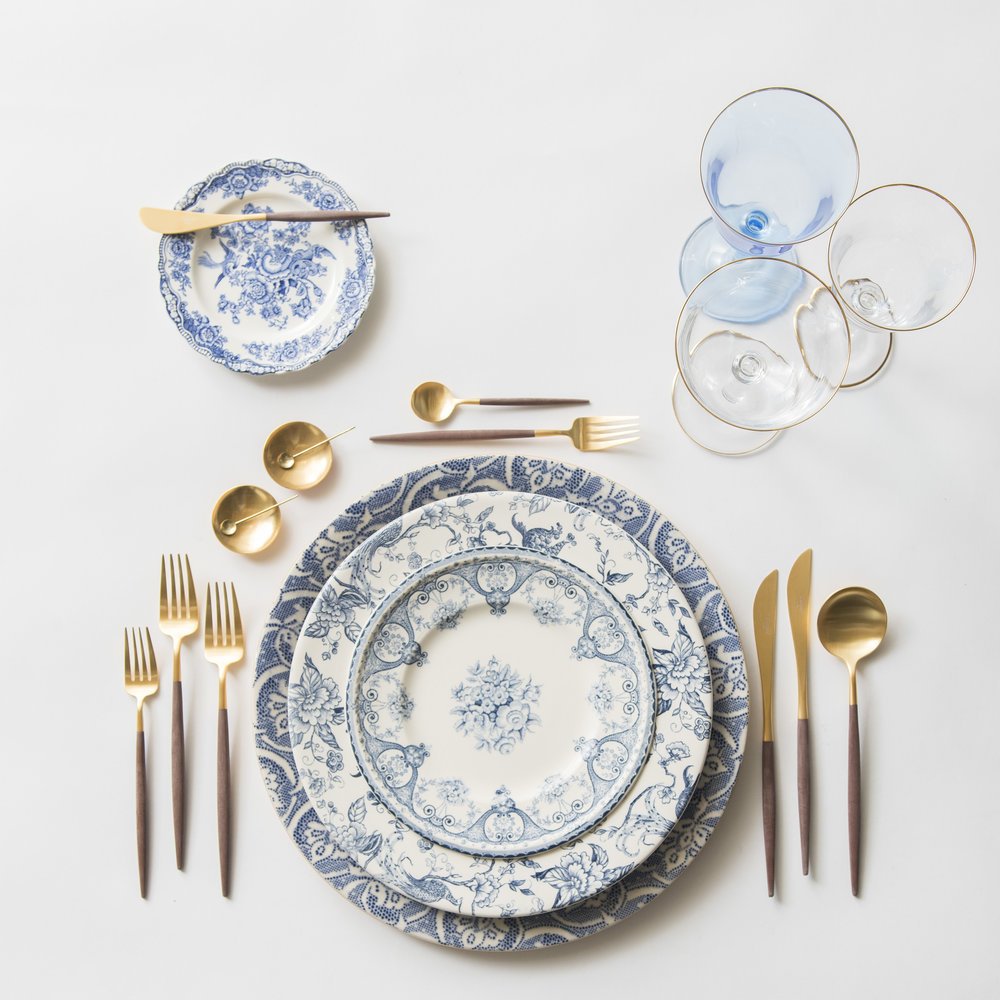 RENT: Blue Fleur de Lis Chargers + Blue Garden Collection Vintage China + Goa Flatware in Brushed 24k Gold/Wood + Chloe 24k Gold Rimmed Stemware + Chloe 24k Gold Rimmed Goblet in Light Blue + 14k Gold Salt Cellars + Tiny Gold Spoons   SHOP: Goa Flatware in Brushed 24k Gold/Wood + Chloe 24k Gold Rimmed Stemware + 14k Gold Salt Cellars + Tiny Gold Spoons